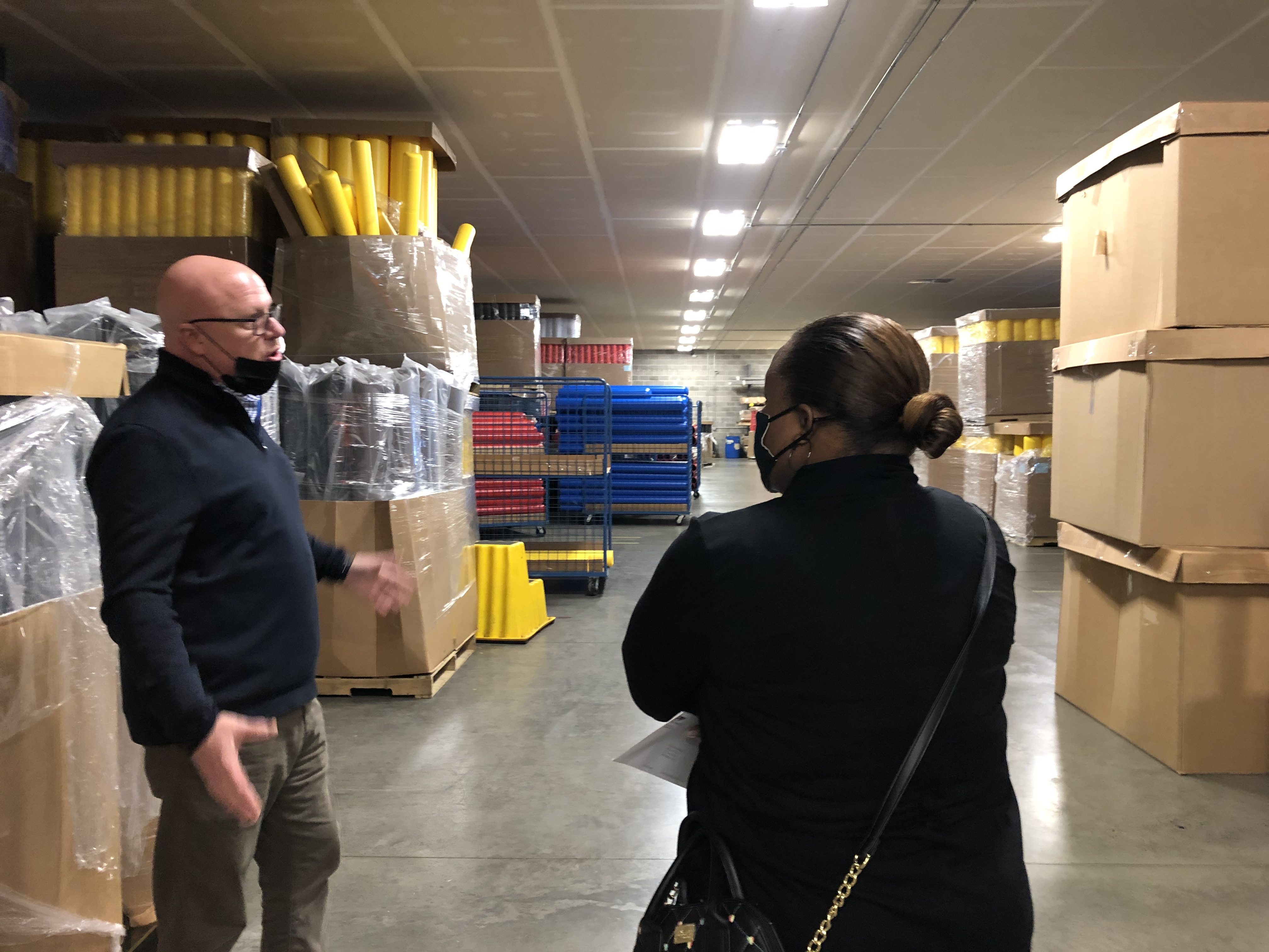 Gary Bowling shows off the warehouse as the team prepares orders.